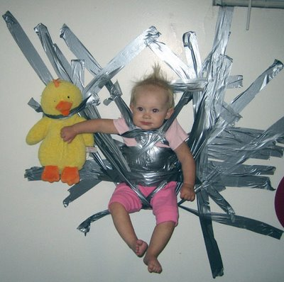 baby duct taped to wall